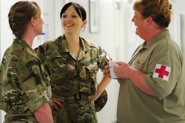 Lanie-Irvin (right chats) to two nurses from the hospital in Camp Bastion Afghanistan
